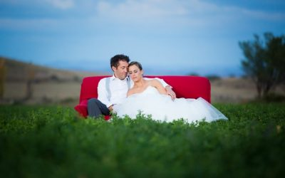 Red chair field bridal couple
